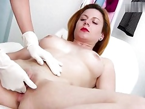 Ultra-kinky crimson haired stunner gets her coochie fuck hole investigated on a gynecology tabouret