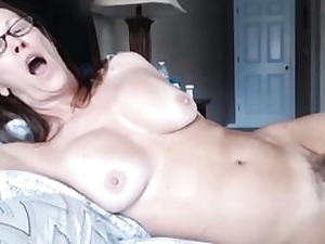 Milf lady laying on bed unveiling her immensely fur covered pussy fuckhole
