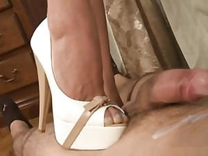 Super-naughty slut is penalizing his ginormous prick with her nasty stilettos and sexy boots